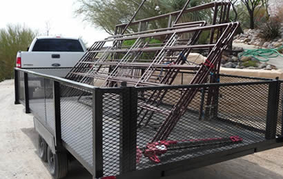 Pieces of steel corral panels are bundled and put on the trailer for traveling